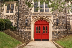sidewalk and red church doors